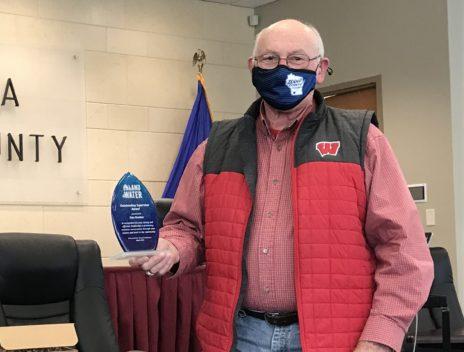 Dan Nankee holds his award.
