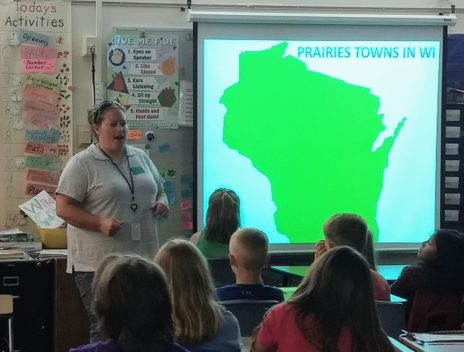 Tracy Arnold presents to a classroom of engaged students.