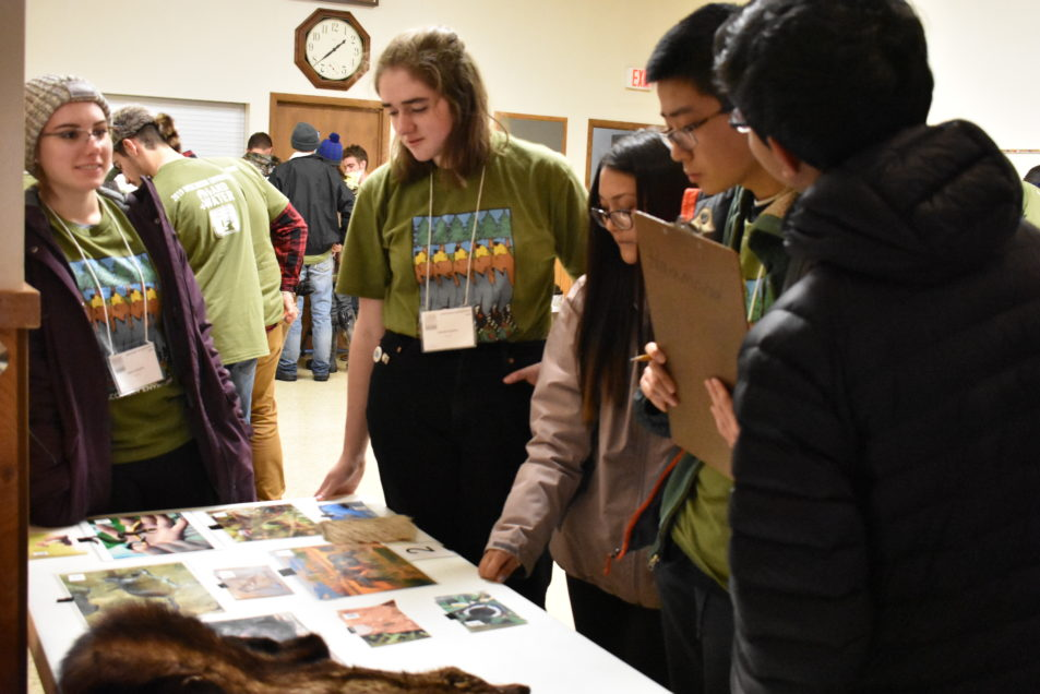 Students around an identification table.